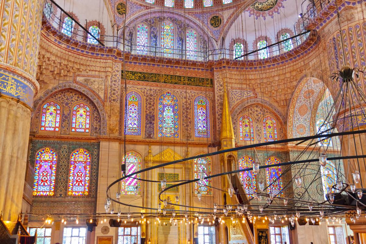 Inside the Blue Mosque are huge chandeliers hanging from the ceiling.