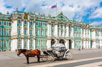 The Hermitage's Winterpalace in St. Petersburg with Horse Carriage