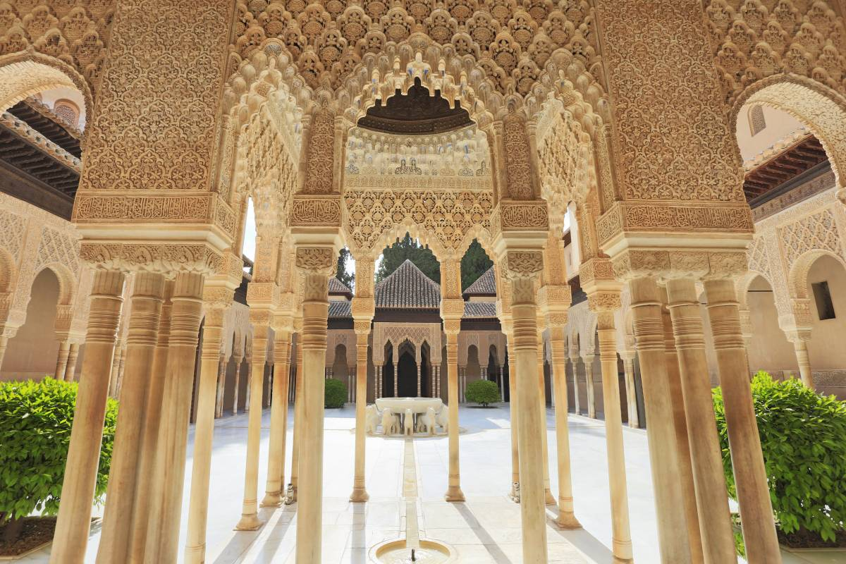 Most beautiful palaces in Europe: A courtyard of the Alhambra Palace in Granada, Spain