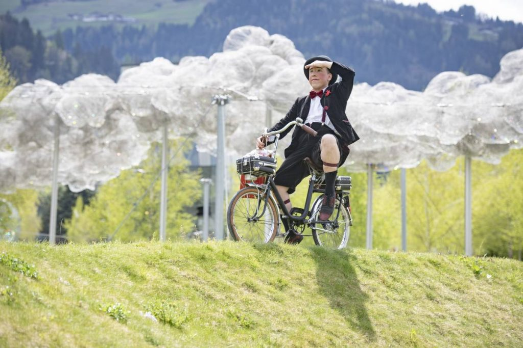 Circus performer on a bike at the Swarovski Crystal Worlds